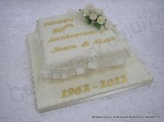 50th Golden wedding anniversary cake covered in an ivory coloured icing with garret frilled sides and piped beading. Decorated with a small spray of spring roses