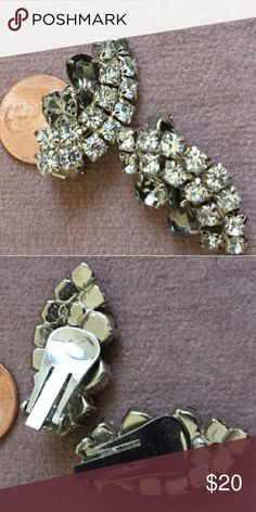Vintage Rhinestone Clip earrings These elegant, high end rhinestone clips have a lot of sparkle! Two rows of prong set clear round stones curve around two larger accent stones, also prong set, and in darker hues, one round and one teardrop shaped, for added interest and sophistication. Unmarked. Vintage  Jewelry Earrings