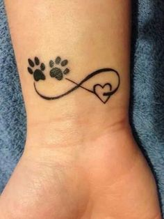 .Paws, infinity, heart wrist tat. Very cute.