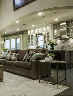 The open floor plans at Bridges at Las Colinas connect the spacious living room to the gourmet kitchen with a professional cooking suite and stunning kitchen backsplash. #dreamkitchen #luxuryhome #interior #design #ideas