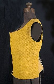Provençal hand-quilted waistcoat, c.1800-30. Made from golden yellow cotton and lined with beige cotton and a thin layer of batting. The layers are hand quilted together with a diamond pattern of perfect little stitches. The brilliant marigold hue has long been associated with Provençal plant dyes of wild sumac, saffron, and sunflower petals.