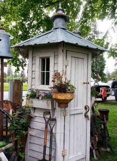 Need a proper storage for all your garden tools? Here's an easy, inexpensive and unique idea for you - a whimsical garden tool shed! While most tool sheds are typically just a nondescript roofed structure in the garden, this one is not only functional, it Greenhouse Shed, Garden Tool Shed, Garden Sheds, Garden Tool Storage, Wood Shed Plans, Barn Plans, Garage Plans, She Sheds, Potting Sheds