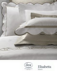 Elegant swirls in gold provide a royal touch for our Elisabetta bed linens | Dea Italy