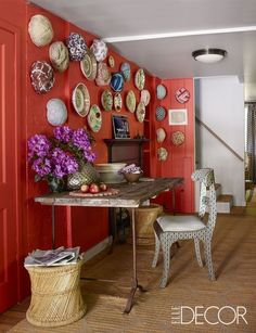This Connecticut country house is filled with colors and patterns. In a corner of the kitchen, an Indian chair and a table from Privet House; the walls are hung with Dutch plates purchased in Sri Lanka and turbans that Robshaw had made in India as gifts for friends.