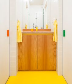 extremely narrow yellow-pine bathroom