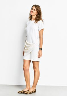 """Elevate your Summer evening look with our Calla wrap dress. The cross-body drape front adds an elegant finish. Accessorise with our mesh strap watch and leopard print shoes. •Easy, straight fit. Try your usual size. •D-ring belt wrap •Zip back closure. •Round neck with short sleeves. •Tunic length, sits mid thigh. •Midweight fabric with slight stretch. •Length 89.5cm (size 10). •Model is 5'9"""" and wears si..."""