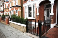 Low stone wall, black railings and gate in contemporary London front garden. Cast Iron Fence, Cast Iron Gates, Front Path, London Brick, Iron Garden Gates, Gates And Railings, Front Gardens, Edwardian House, House Front