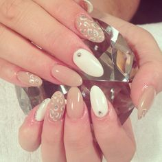 Nude white and silver almond shape acrylics with leopard print nail art