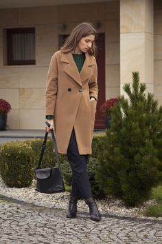 Camel coat and emerald sweater.