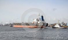 Large vessel being towed into IJmuiden, the Netherlands