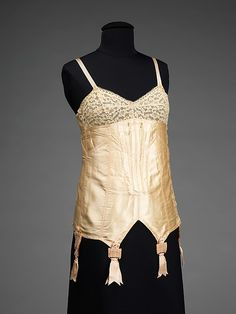 """Corselets during the 20s represent the final stage of """"relaxed"""" corseting as from here to Dior's New Look corseting only gets more restrictive until it disappears. The corset matches the ideal silhouette during the 20s- boyish, boxy, androgynous."""