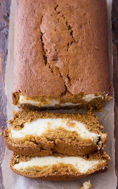 Cream Cheese Filled Pumpkin Bread Recipe - This delicious and moist pumpkin bread has a yummy cream cheese filling. It's so good and so, so pretty!