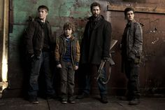 """The Mason family, Ben, Matt, Tom and Hal from the TV Show """"Falling Skies""""."""