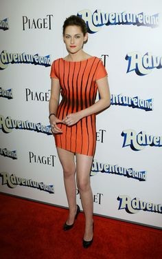March 16, 2009: For the Los Angeles premiere of Adventureland, Stewart wore a coral bandage Herve Leger dress by Max Azria from the Spring 2009 collection. She finished off her look with black patent heels by Burberry.