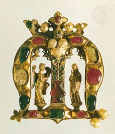 The Founder's Jewel, in the form of a crown letter M and composed of gold, emeralds, rubies, pearls, and enamel, c. 1400; in the collection of New College, Oxford.