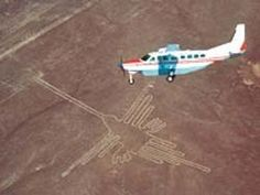 Mysterious Nazca lines in Peru, depicting hummingbird and other images, were created by an ancient civilization.  It can only be truly seen by air. This and the other huge designs cover a 50 mile area and were created by moving dark stones to reveal lighter area underneath.