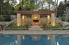 Outdoor Living Room With Fireplace Stainless Steel Candle Lantern Green Decorative Pillow Pergola Living Room Natural Stone Flooring Stone Fireplace : Home Improvement and Interior Decorating Outdoor Fire, Outdoor Pool, Pool Backyard, Outdoor Seating, Backyard Ideas, Garden Ideas, Outdoor Living Areas, Outdoor Spaces, Living Spaces
