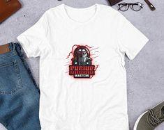 Etsy Bunti Munti World Grafik-Bilder von Zauberbazar auf Etsy Design Shop, Etsy, Mens Tops, T Shirt, England, Fashion, T Shirt Pillow, Kleding, Supreme T Shirt