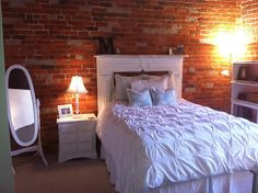 exposed brick and a mantle turned headboard, count me in!