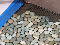 diy pebble floors; cool idea for bathroom; wonder if I could do this to a counter top? @amandabde
