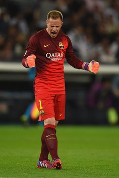 Marc-Andre ter Stegen of Barcelona celebrates after Luis Suarez of Barcelona scored their third goal during the UEFA Champions League Quarter Final First Leg match between Paris Saint-Germain and FC Barcelona at Parc des Princes on April 15, 2015 in Paris, France.