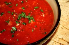 How to make a restaurant style salsa, with canned tomatoes, onion, jalapeno, garlic, a little lime juice and cilantro, whirled up in the food processor to give you a nice smooth texture.