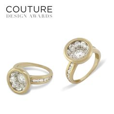2013 Couture Design Award - 1st Place in the Bridal Category. The winning piece, above, is a 14k yellow gold tapered ring with a parabolic setting (patent pending), holding nine 4mm x 3mm oval white diamonds around a 5mm round brilliant cut white diamond. The setting is flanked by twelve 2mm channel set round white brilliant cut diamonds. The ring contains a total of 2.62 Carats.