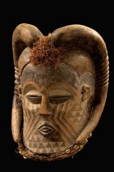 Africa | Helmet mask from the Kuba people of DR Congo | Wood, polychrome paint, plant fiber