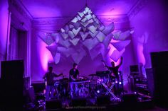 If its light, you can hang it from the ballroom ceiling. This incredible effect was with tissue paper pyramids and some genius projection.