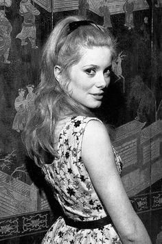 Catherine Deneuve attends the premiere of Les Parapluies de Cherbourg at Cannes Film Festival, 1964.