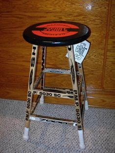 hockey stick and puck seat bar stool... how. freaking. cool.