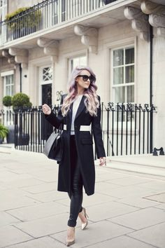 Strutting through Kensington in Jimmy Choos, a Givenchy black wool coat, a Fendi tote, Joseph leather leggings and Celine New Audrey Sunglasses