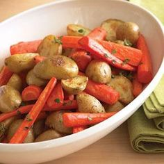Tender spring-dug potatoes and carrots need very little fussing over. Simply roast them and toss with thyme and butter for an easy side dish. Carrots In Oven, Roasted Potatoes And Carrots, Roasted Vegetables, Veggies, Rosemary Potatoes, Fingerling Potatoes, Carrot Recipes, Vegan Recipes, Cooking Recipes