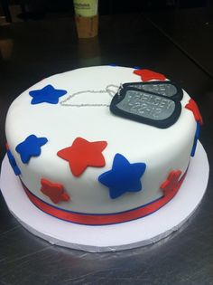 Simple yet honorable military cake. Dog tags have soliders name and deployment date