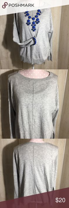 """Gap Street Style Casual Sweater in Gray Solid color, light weight knit sweater. Style no. 989047. Seam down middle is chest and back. Bottom band is split at the sides for ease of movement. 55% nylon 30% wool 15% acrylic. Machine wash cold and dry flat. Measurements are approximate laying flat. Bust 23"""" length 25"""" GAP Sweaters"""