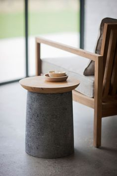 Kanik table made out of reclaimed teak and volcanic stone by Trunk