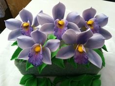 Gumpaste Cymbidium Orchid Cake Decoration Lavender Gum Paste. $7.00, via Etsy.