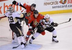 Pittsburgh Penguins' Sidney Crosby, right, ties up Ottawa Senators' Kyle Turris in front of Penguins' goalie Marc-Andre Fleury as Sens' Kaspars Daugavins, back, moves in during NHL hockey action at the Scotia Bank Place in Ottawa on Sunday, Jan. 27, 2013. (AP Photo/The Canadian Press, Sean Kilpatrick)