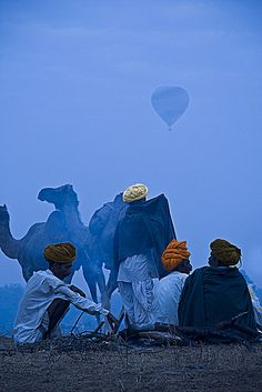 India - Camel Herders watching a Hot Air Balloon