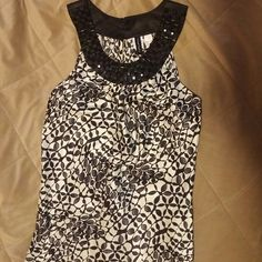 Heart & Soul tank w/beaded collar Heart & Soul tank with beading around the collar and a high neck line. 3 buttons at the collar in the back secure it. 100% polyester and 100% perfect condition! HeartSoul Tops Tank Tops