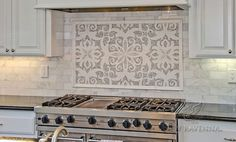This custom Arabella mosaic backsplash is shown in polished Carrara and Thassos and is part of the Silk Road Collection by Sara Baldwin for New Ravenna. -photo courtesy of Da Vinci Marble Stove Backsplash, Mosaic Backsplash, Backsplash Ideas, Travertine Backsplash, Beadboard Backsplash, Herringbone Backsplash, Dark Granite Countertops, New Ravenna, Kitchen Tiles