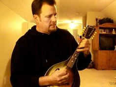Arkansas Traveler on mandolin
