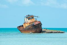 South Dock Tugboat - This tugboat can be seen stuck on a tiny rocky cay near the radar installation at South Dock, Providenciales. #VisitTCI