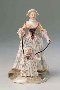 1760 German Porcelain Figurine at the Sammlung Ludwig, Bamberg - This figurine shows us how the leading strings sewn onto the back of toddlers' clothing would have been used.