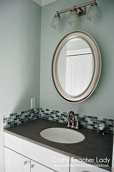 "4""/6"" tile backsplash in your bathroom-- paint with some type of back splash behind the sinks"