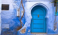 A bright and vibrant picture of a blue front door in a blue house wall shot in the largely blue town on Chefchaoun in the Rif region of Morocco. TITLE: Blue Door in Blue Wall SIZE: x print with additional white border for EASY MOUNTING. Moroccan Art, Moroccan Design, Moroccan Style, Moroccan Blue, Moroccan Doors, Moroccan Interiors, Style At Home, Arched Front Door, Chefchaouen