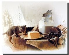 If you want to enhance the look of your home add this country cute kitten art print poster. This poster display the image of a kitten eating homemade butter lying on a table is sure to make this poster eye catchy and grab lot of attention. So Hurry up and buy this charming wall poster for its wonderful paper quality with perfect color accuracy.