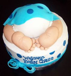 one of the cutest baby shower cakes I've ever seen! it can also be pink!:)