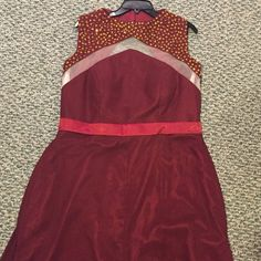 Fab! Plus size Prom Dress Plus size burgundy dress bought off manufacture website in Asia.Size 18. Never worn! Gold sequins on top lead to mesh cutout flows to belt to accent the waist small slit to show off legs  Gold sequins also on back with diamond shape cutout Built in bra Hook closure at top and zipper closure  Small train in the back to add elegance  There is a small stain in the skirt area That's how I got it but barely noticeable Approx measurements bust: 18in waist: 20in Slit is…