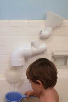 white plumbing tubes on wal for water play
